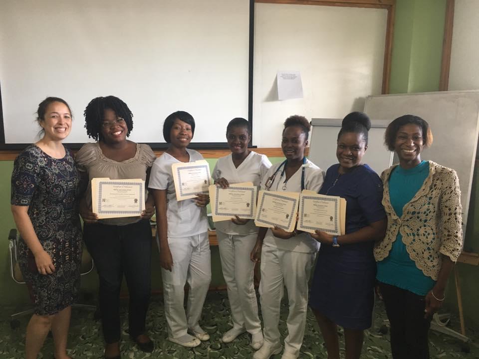 Volunteer nurse supervisor Trisha Groschel, BSN, RN, left, among Haiti Adventist Hospital's newly certified nursing staff.