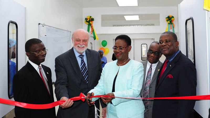 Haiti's first lady cutting the ribbon at the new surgical suite as Hart, second left, and others watch.