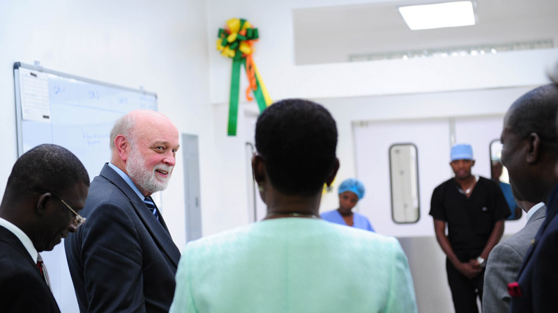 Richard Hart, MD, DrPH, president of Loma Linda University Health and Adventist Health International tours the new surgical suite along side Haiti's first lady and other honored guests.