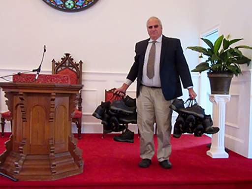 Pastor Greg Carlson with the given shoes