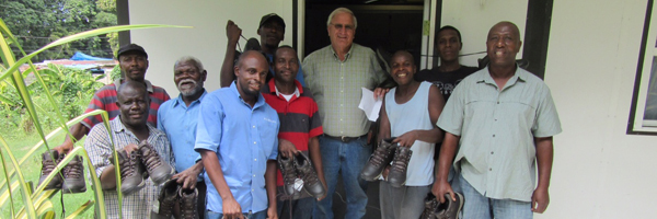 Pastor Carlson with the shoes and Haitians
